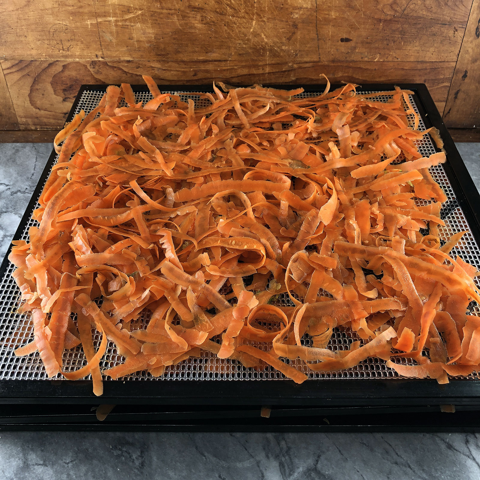 Carrot peel on drying tray