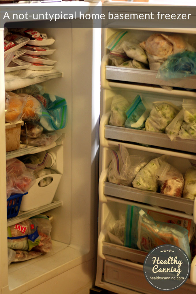 A crammed home basement freezer. Keeping food tidily organized in a freezer can be more of a challenge than in jars on a shelf.