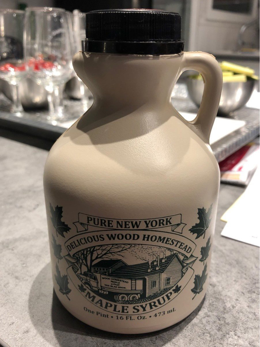Beige plastic maple syrup jug with limited storage life